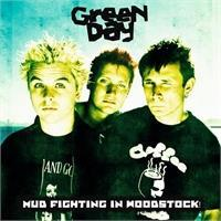 green-day-mud-fighting-in-woodstock